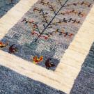 アマレ・150×102・青・生命の樹・鳥・窓・センターラグサイズ・アップ画