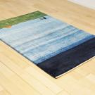 カシュクリ・138×95・青・羊・木・朝日・グラデーション・センターラグサイズ・玄関サイズ・使用イメージ画
