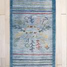 アマレ・134×80・青・草木・ラクダ・鹿・鳥・玄関サイズ・真上画